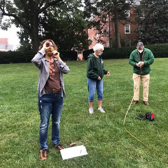 Members of Frederick County Forestry Board measuring campus trees
