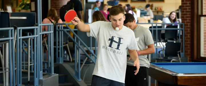 Student playing ping-pong