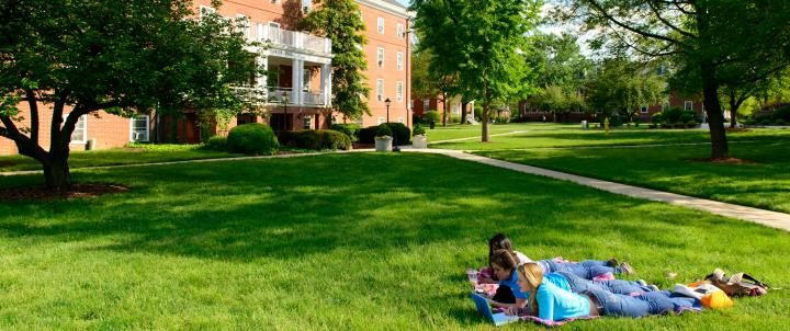Students laying on quad