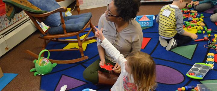 Student teacher with preschooler