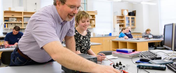 Physics professor with student