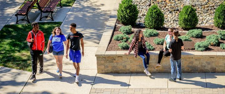 Students walking through plaza