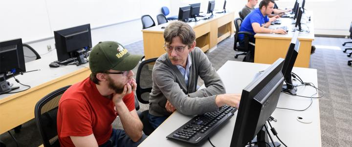Professor with student at computer